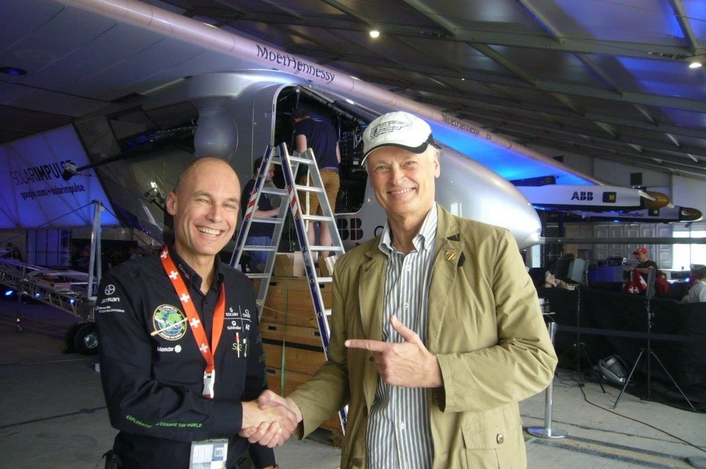 Abu Dhabi: Solar Impulse pilot Bertrand Piccard (left) receiving good luck wishes from Bernard Weber, Founder-President of New7Wonders (right), before his historic flight.